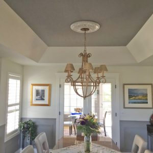 Dining room painted off white with bluish grey wainscot